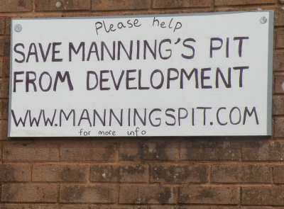 Sign on garage wall, Windsor Road, close to                 Maning's Pit