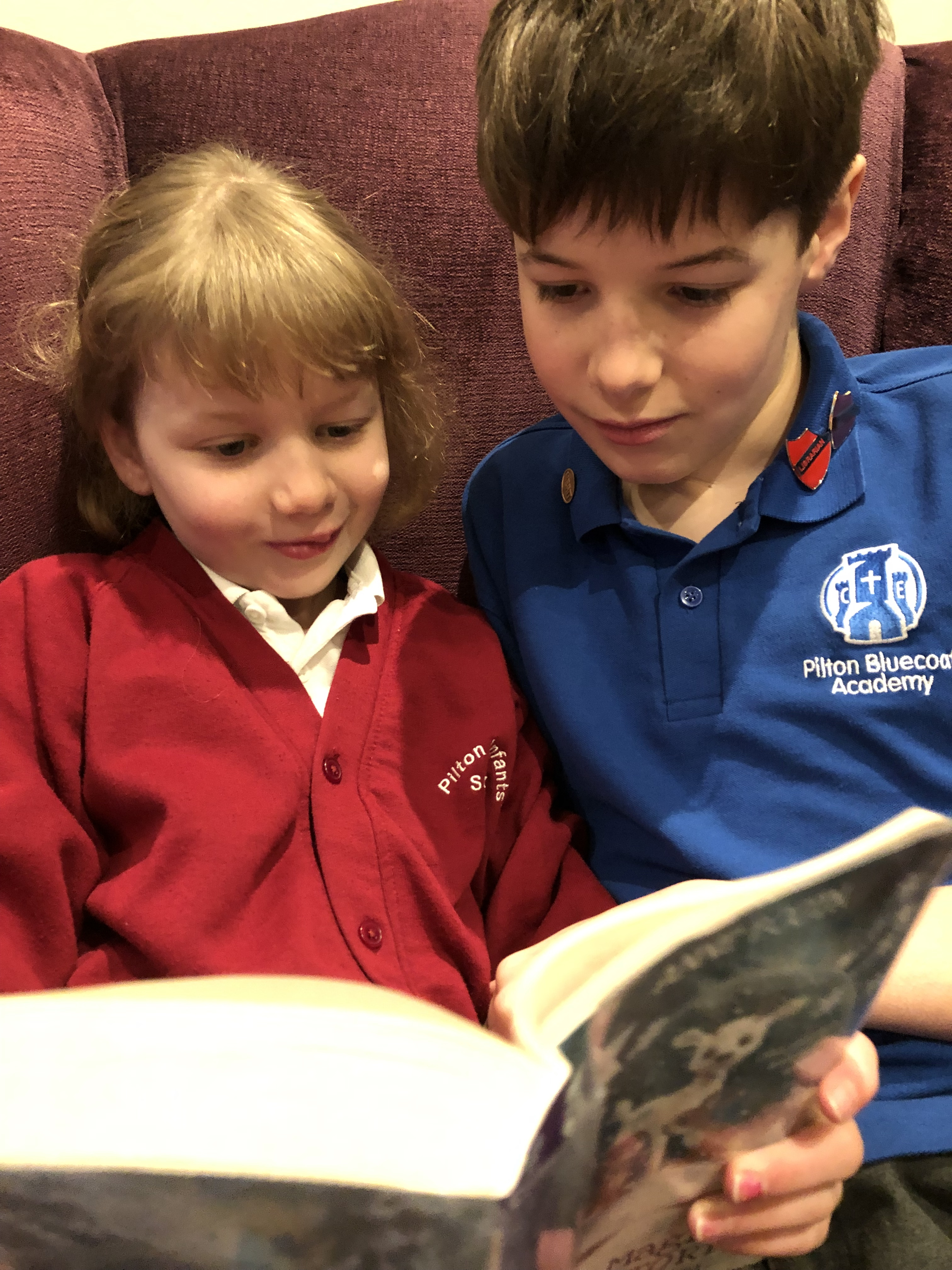 Alex Meller reading to his sister